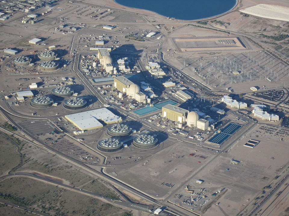 A nuclear powerplant complex in Arizona, set against the tan desert.