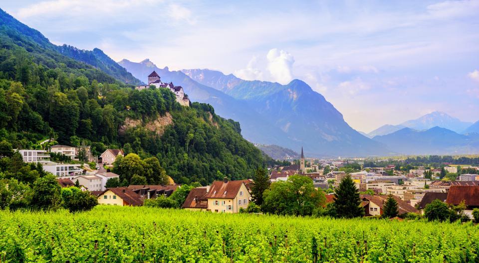 Vaduz town, the capital of Liechtenstein with the Alps in the background