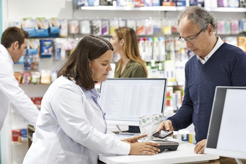 Customer paying through smart phone at counter