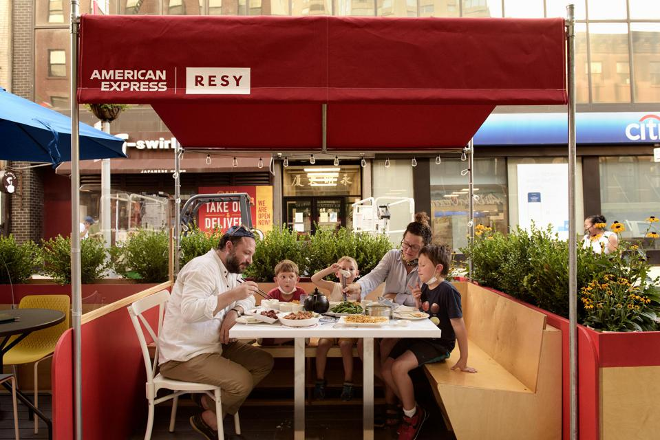 family in outdoor dining