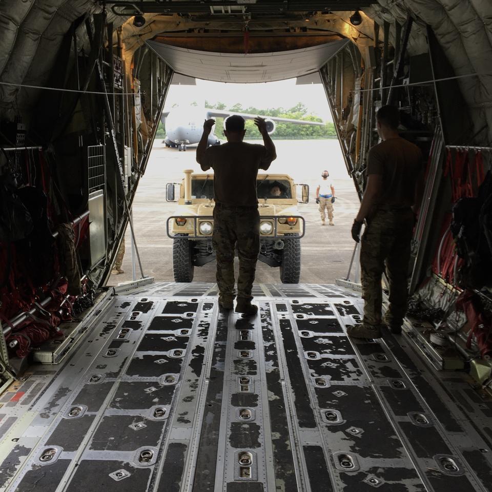 Loading a Humvee into C-130.