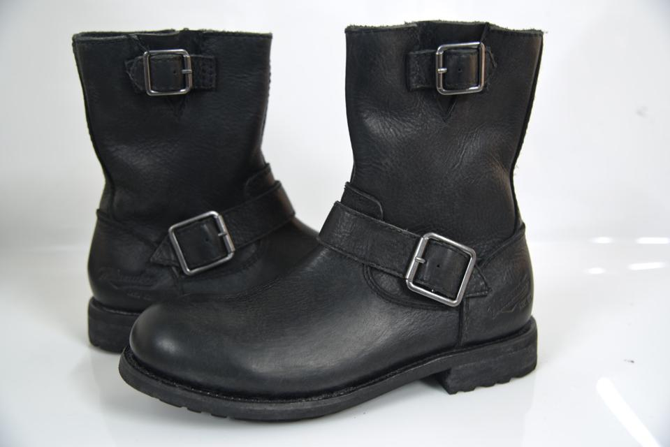 Biker-inspired boot, handcrafted with leather and a Goodyear welted rubber outsole. Available in dark brown or black.