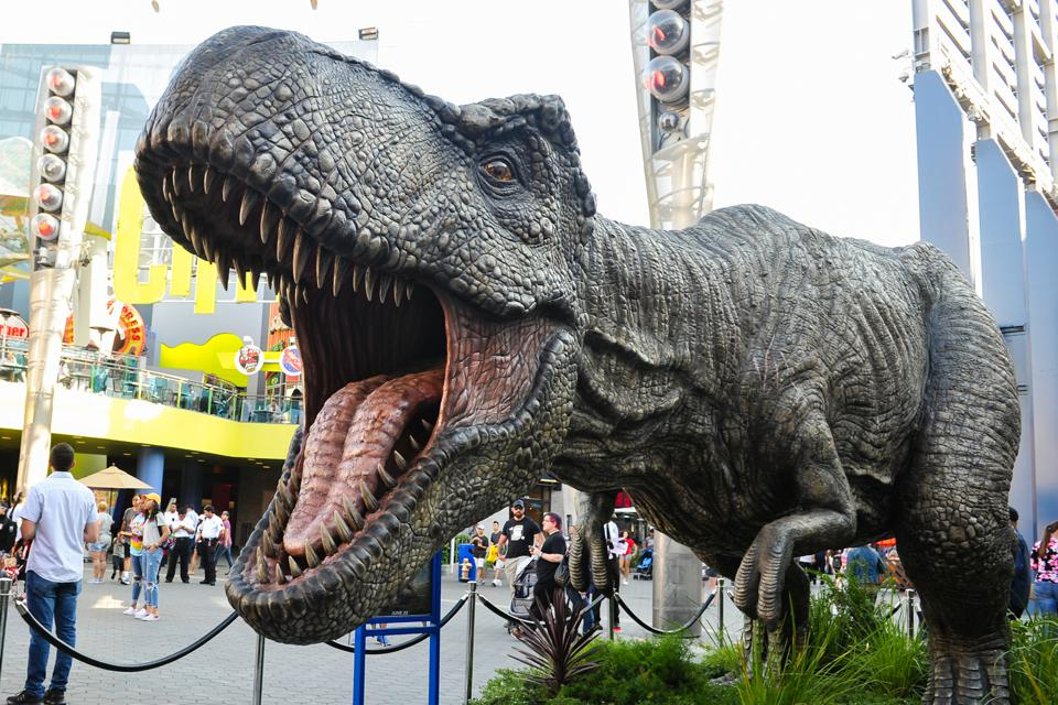 A Tyrannosaurus rex, towering 13-feet tall by 36-feet wide and weighing three tons, is displayed outside Universal Cinema.