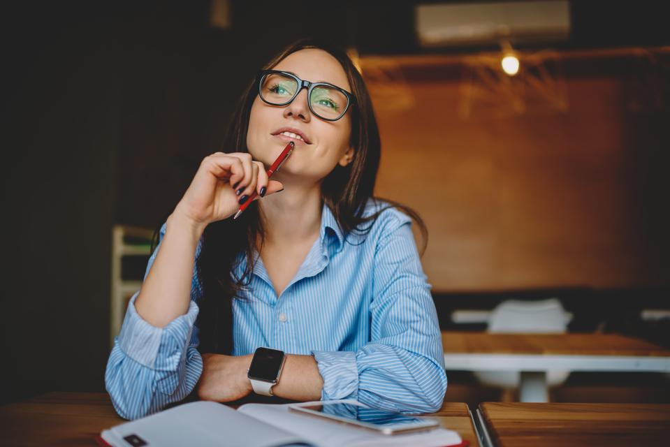 Woman taking time to reflect and express gratitude in a  virtual team retreats