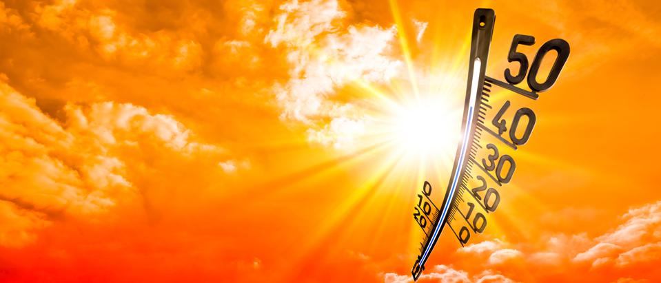 Summer background, bright sun on dramatic sky with thermometer