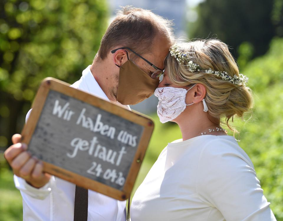 In love couple wearing covid masks get married in Austria amid Europe travel bans