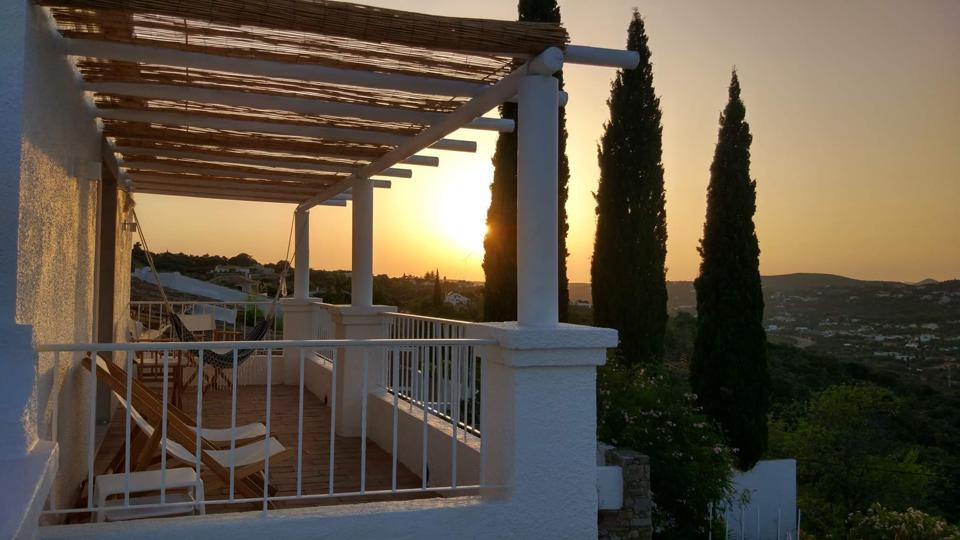 The sun sets behind the hotel in the Algarve, Portugal.