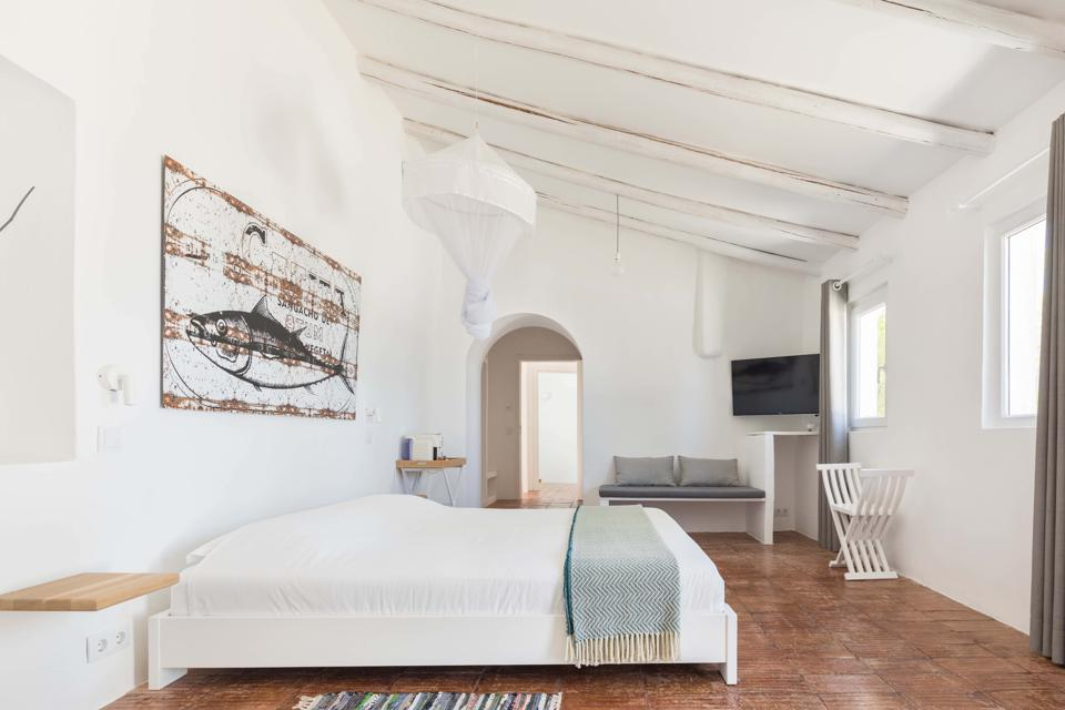The bedrooms have terra-cotta floors and artwork inspired by the Algarve fishing industry.