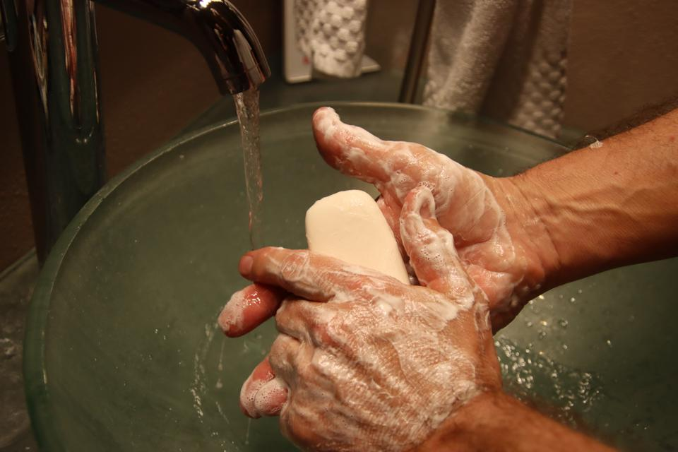 Washing hands with soap and water.