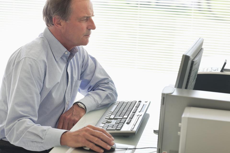 Businessman using computer at desk