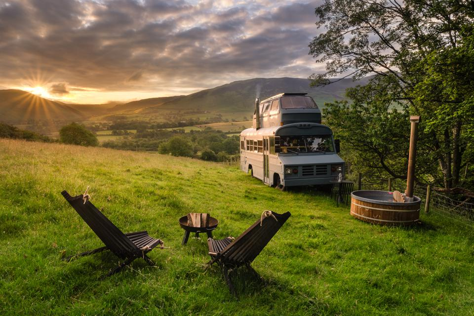van and chairs in countryside