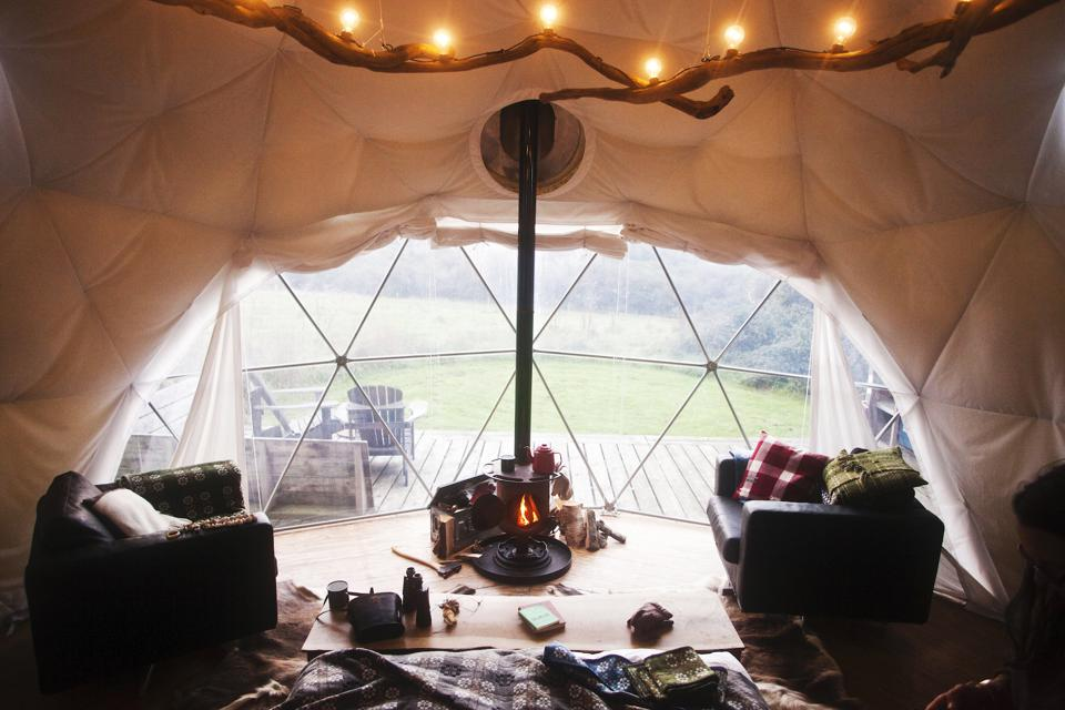 A posh tent with wood-burning stove
