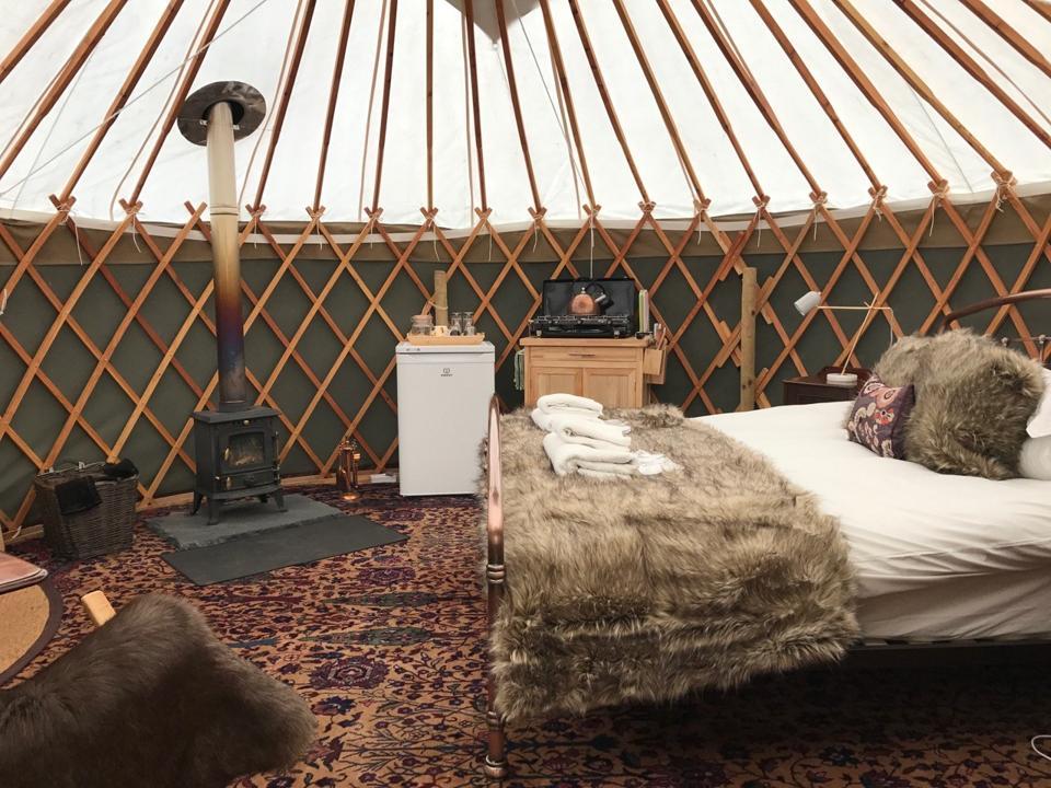 Inside of a glamping yurt.