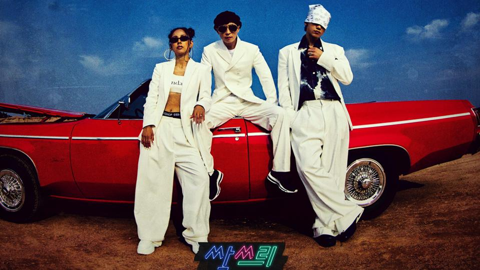 Lee Hyori, Rain, and Yu Jaeseok posing in 90's style white clothes with a red convertible
