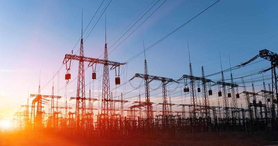 High-voltage power lines. Electricity distribution station. high voltage electric transmission tower. Distribution electric substation with power lines and transformers