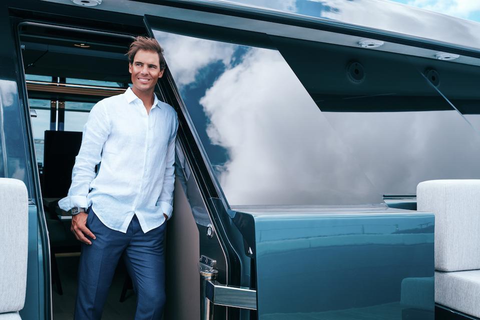 Raphael Nadal and the custom-built door and mirrored glass of his Sunreef 80 catamaran Great White.