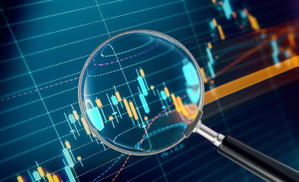 Magnifier Focusing On A Financial and Technical Data Analysis