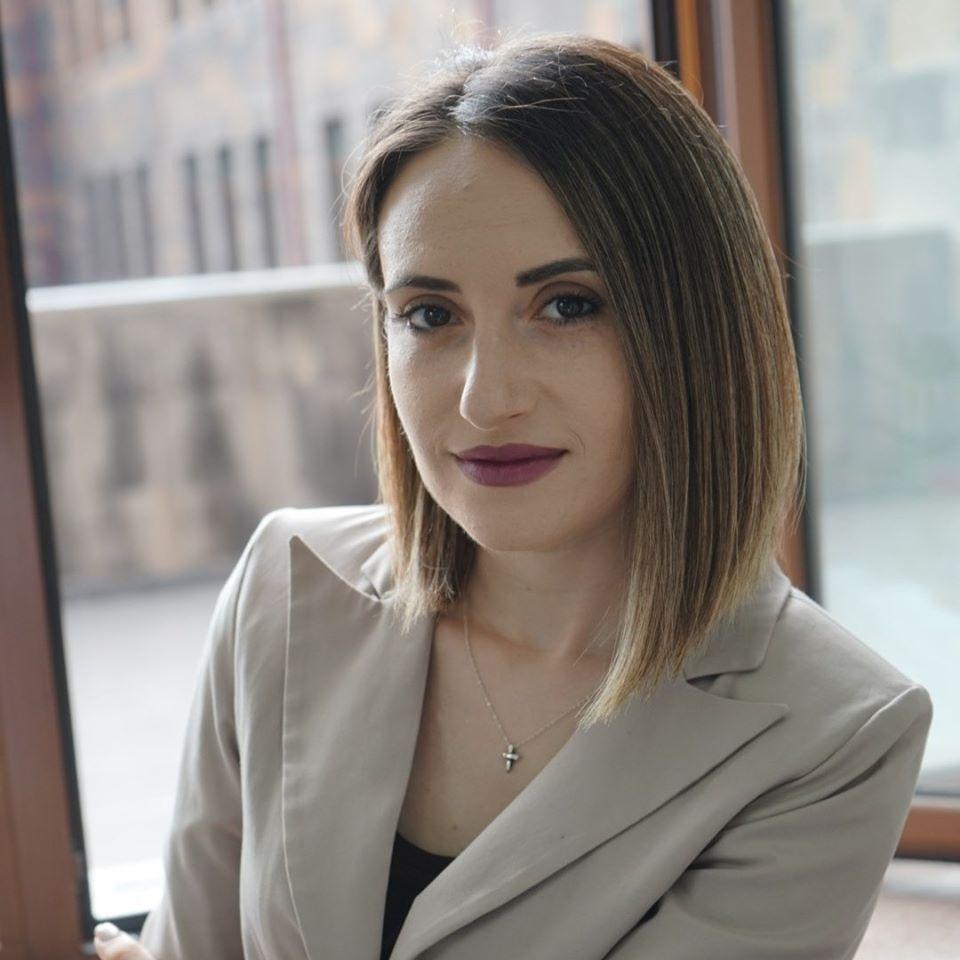 Gayane Ghandilyan Arakelyan - sitting by a window.
