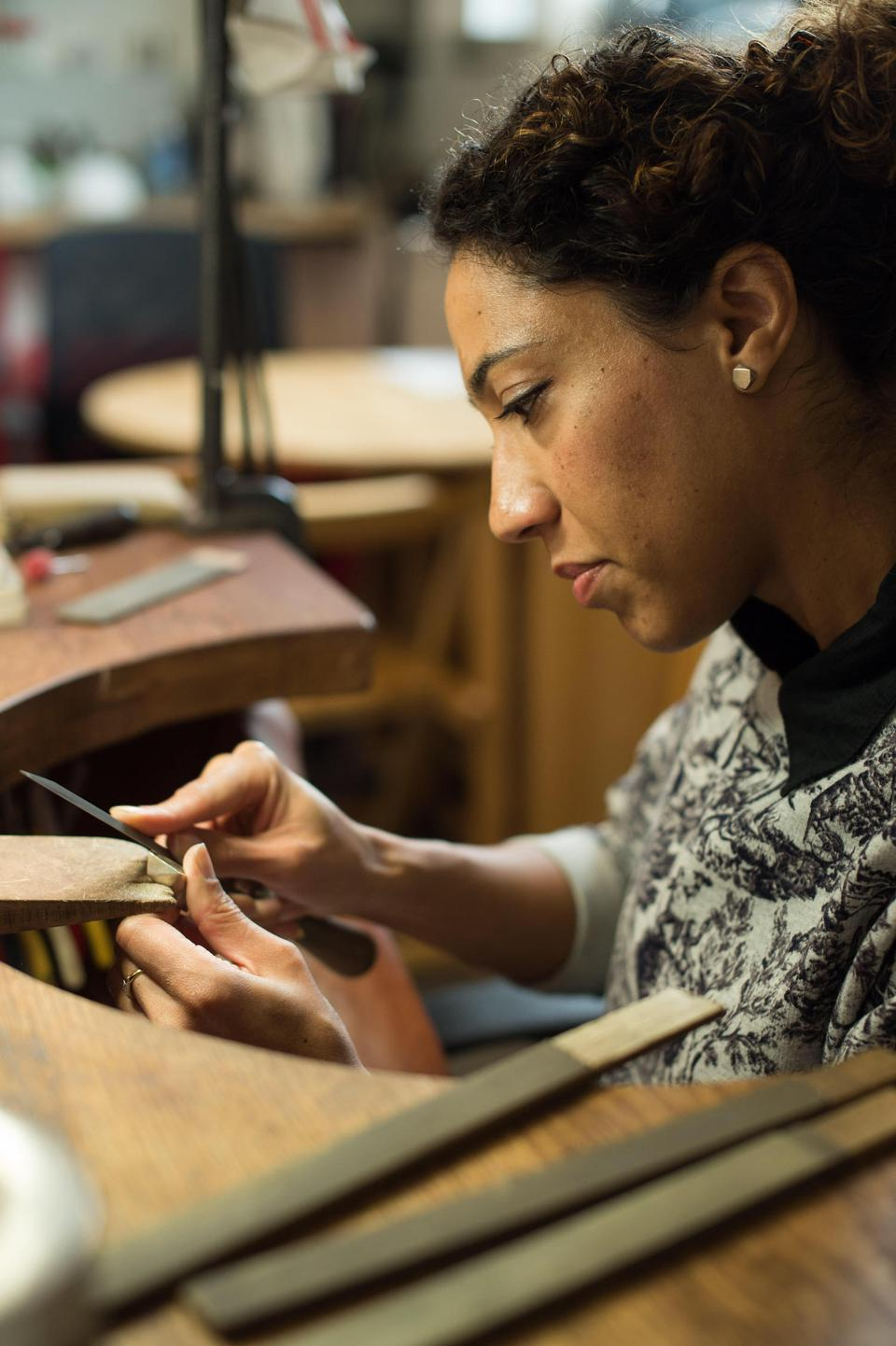 Jewelry designer Melanie Eddy working at the bench.