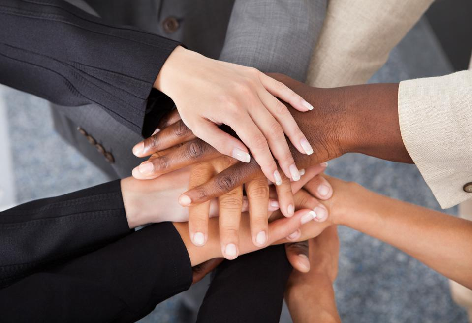 Multiracial Businesspeople Stacking Hands