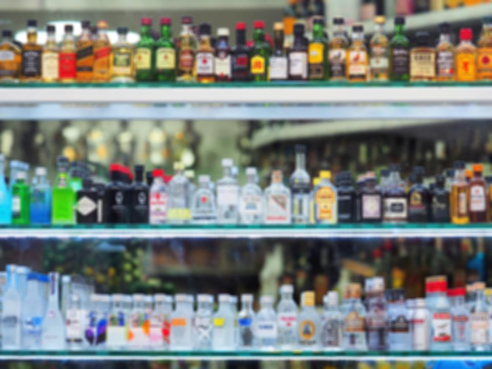Glass showcase with alcohol products.