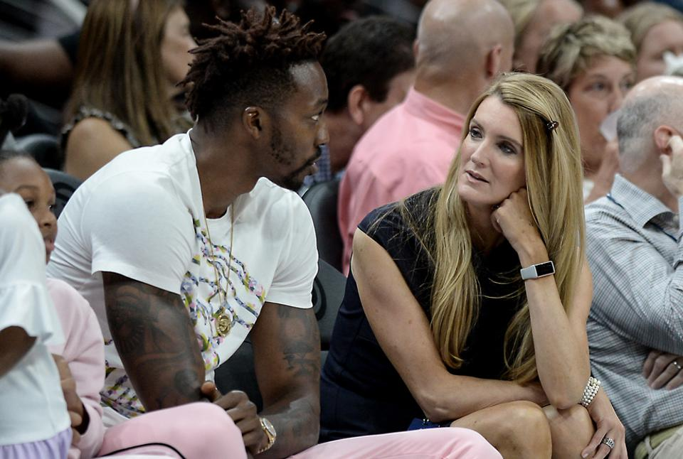 ATLANTA, GA – JULY 23: Atlanta Dream owner Kelly Loeffler (right) speaks with veteran NBA player Dwight Howard (left) during the WNBA game between the Los Angeles Sparks and the Atlanta Dream on July 23rd, 2019 at State Farm Arena in Atlanta, GA. (Photo by Rich von Biberstein/Icon Sportswire) (Newscom TagID: iconphotosfive371497.jpg) [Photo via Newscom]