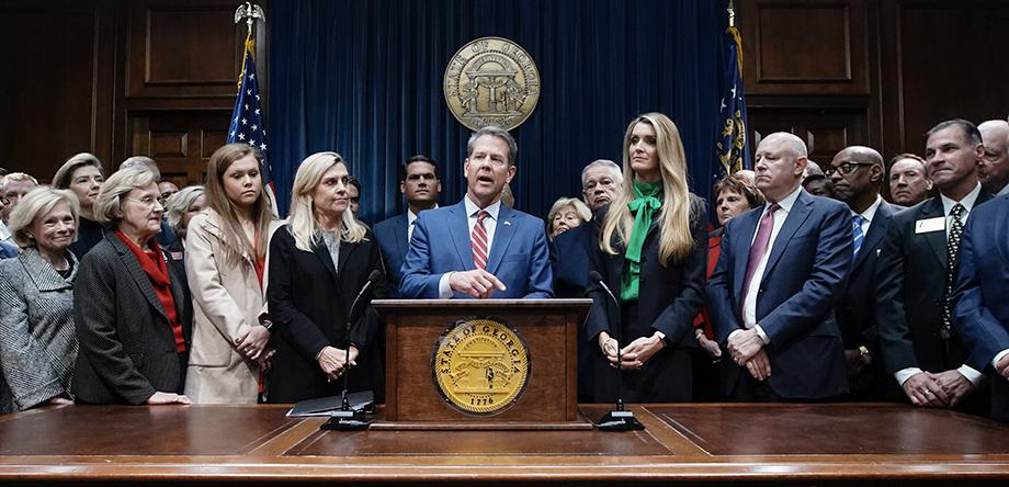 Georgia Gov. Brian Kemp takes questions from the press following the introduction of businesswoman Kelly Loeffler