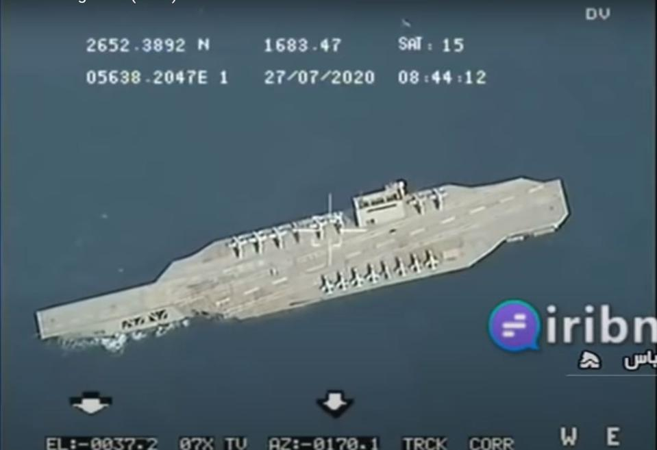 Iranian mock aircraft carrier in targeting cross hairs about to be struck by missile.