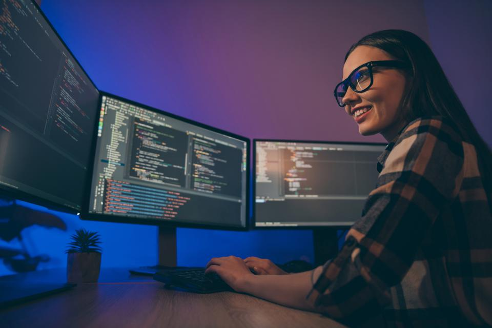 Low below angle view photo of cheerful woman finishing developing computer game solving all the current problems