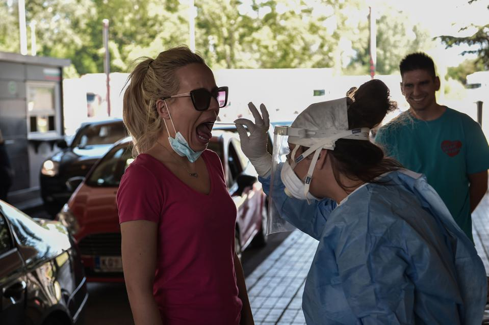 GREECE-healthworker-conducts-Covid-19-swab-test-on-arrival-from-Bulgaria