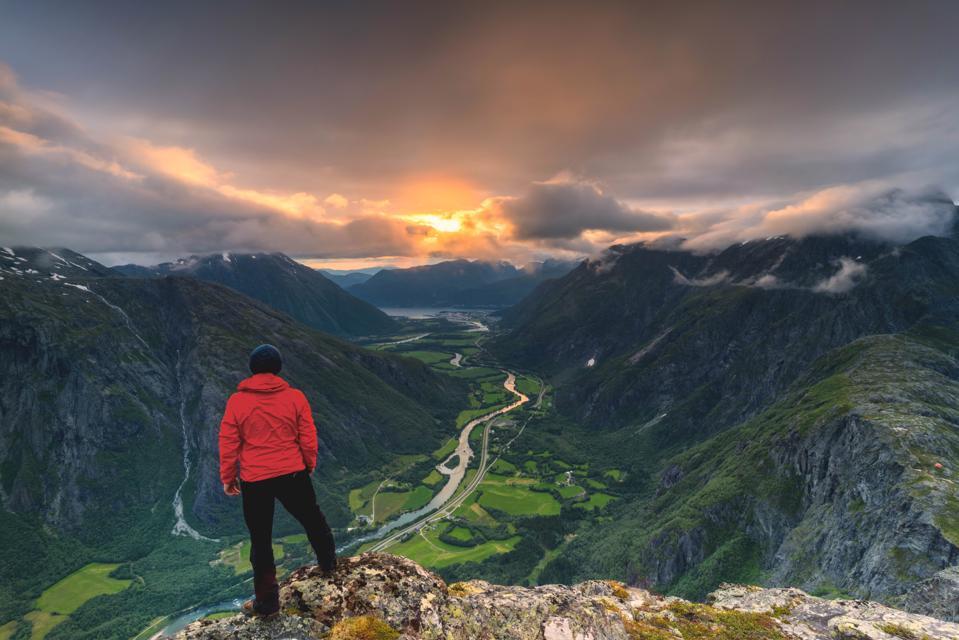 Hiker on Romsdalseggen ridge in Åndalsnes, Norway.
