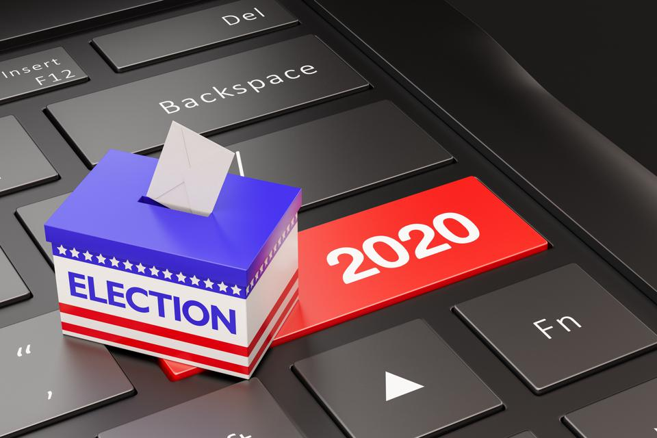 Election ballot box on top of keyboard with a 2020 enter key in red