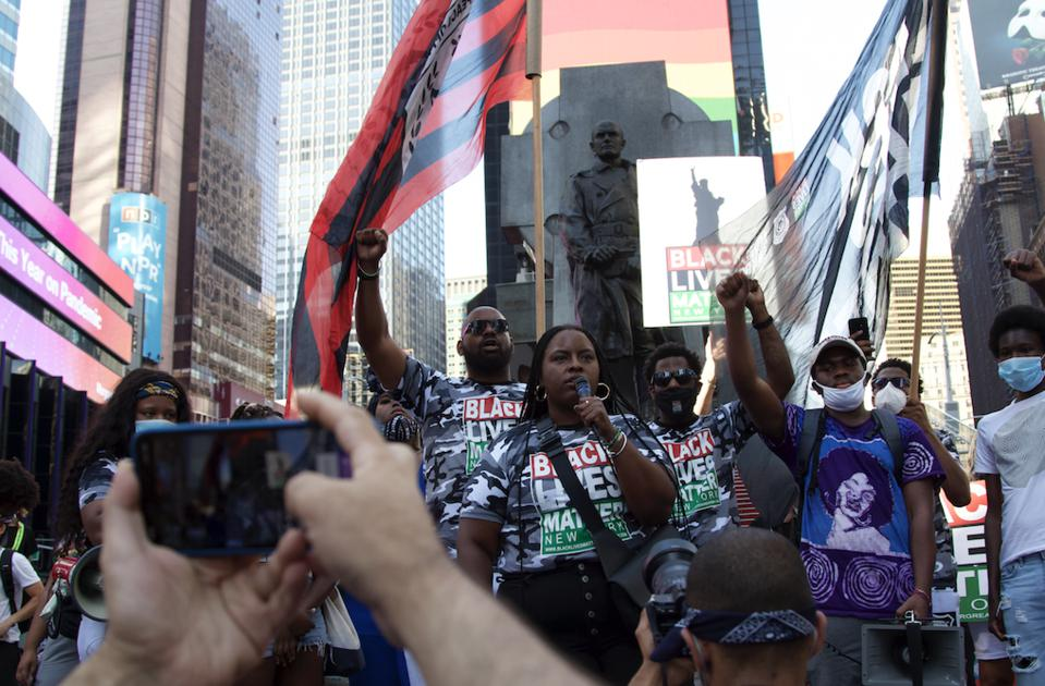 Chivona Newsome speaking during March for Black Womxn on July 26, 2020, in New York's Times Square