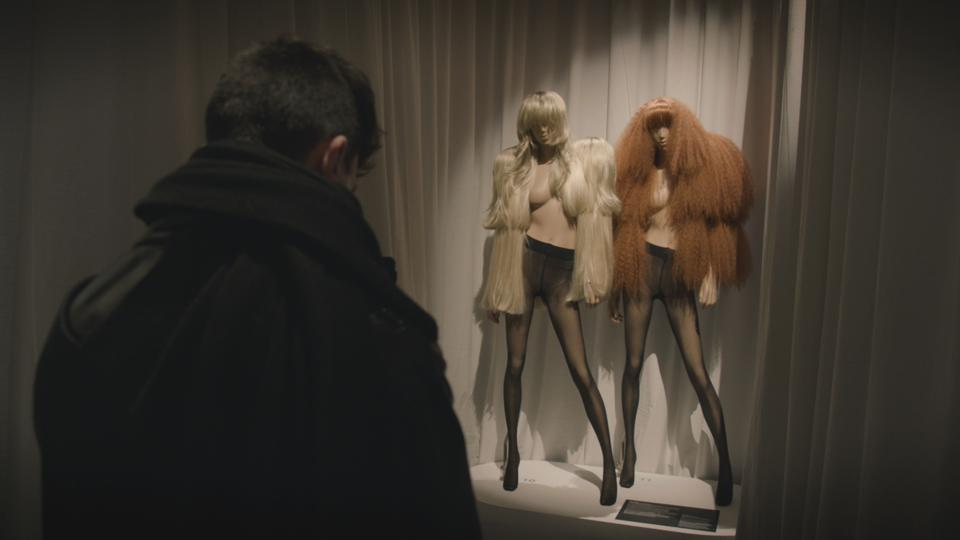 art exhibition with mannequins