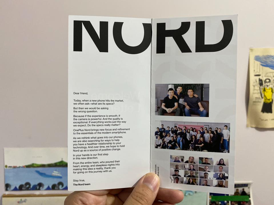 A promotional pamphlet showing the OnePlus team.