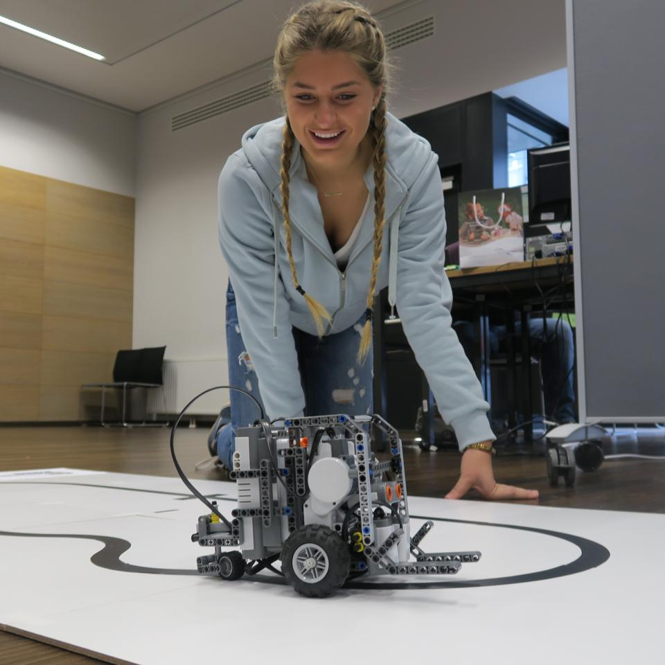 A girl working on a robot project for Gap Year.