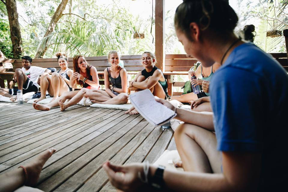 Gap Year students in a group on a deck.