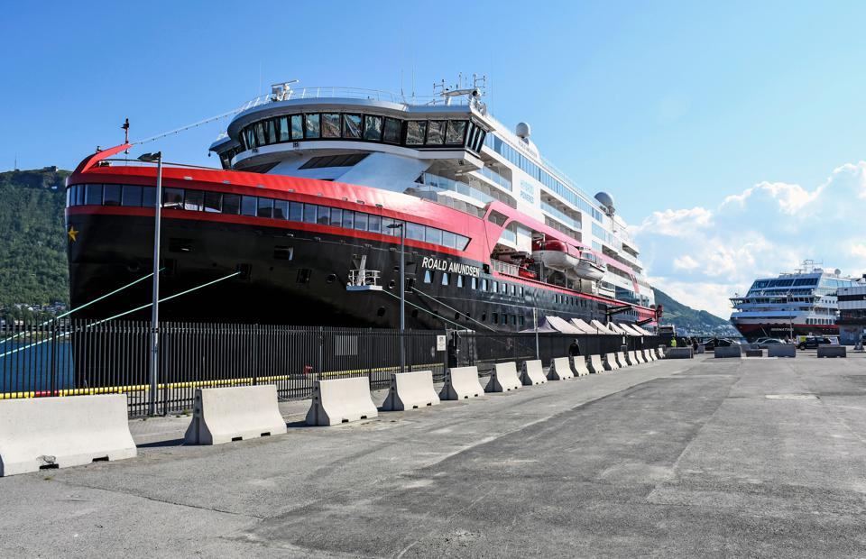 Hurtigruten expedition cruise ship MS Roald Amundsen moored at a quay in Tromsø, Norway.