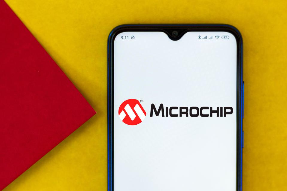 In this photo illustration the Microchip Technology...