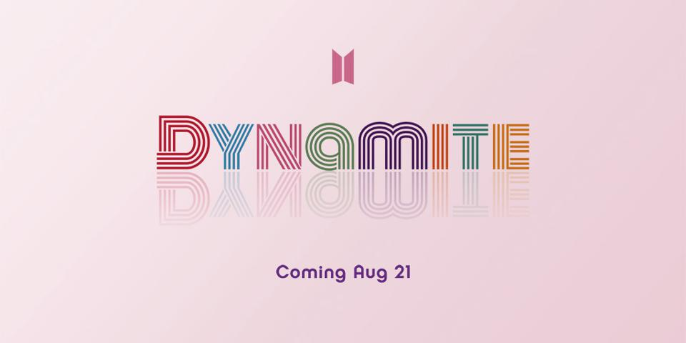 Multi-colored logo ″Dynamite,″ between BTS's logo in pink & ″Coming Aug 21″ in purple.