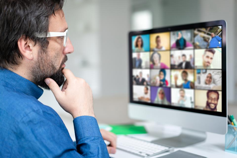 Man working at home having a video conference with colleagues