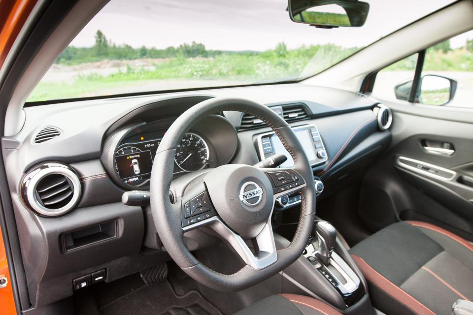Dashboard of 2020 Nissan Versa showing flat-bottomed steering wheel and 7-inch infotainment screen