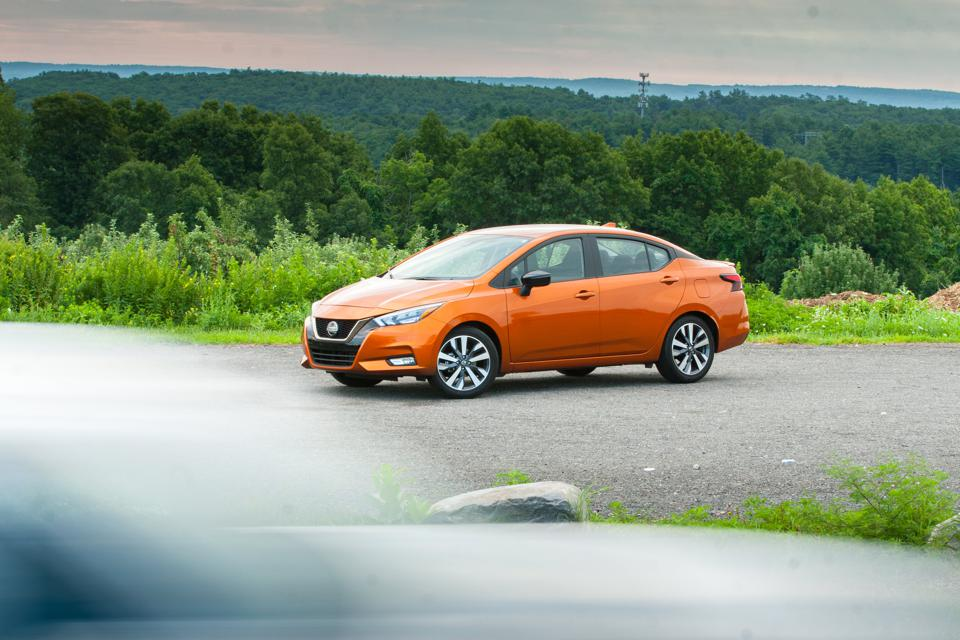 2020 Nissan Versa SR parked as a blurry vehicle passes in foreground