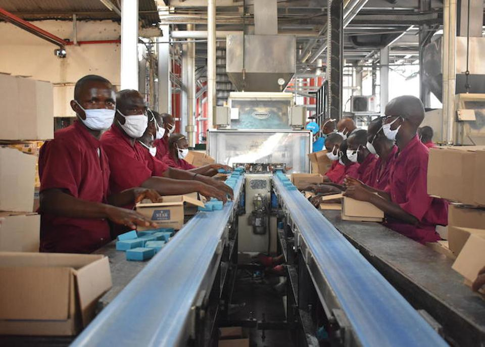Blue soap rolls off the production line at the Savonor factory in Bujumbura, Burundi.
