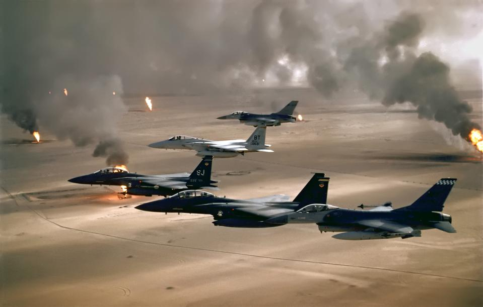 U.S. warplanes flying over burning Kuwaiti oil well in the Gulf War.