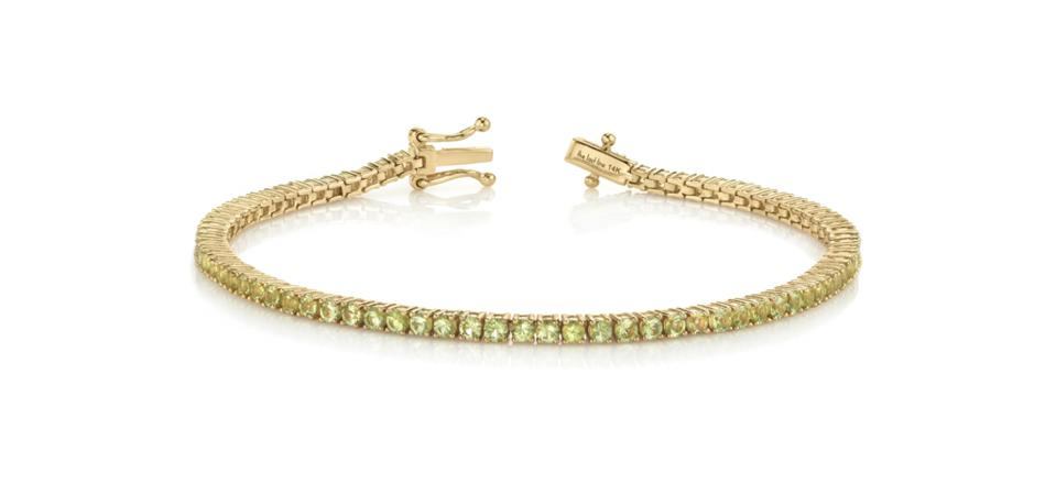 The Last Line tennis bracelet in 14K yellow gold with peridot, from $1,415, thisisthelast.com