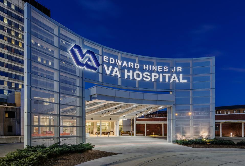 The illuminated facade of the Edward Hine, Jr. VA Hospital in Hines, Illinois.