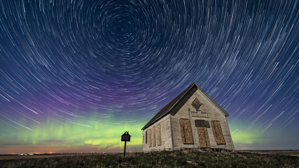 In any star-trail image taken from the northern hemisphere Polaris, the North Star, will be the at the center—it's the only star that never appears to shift its position. (Photo by: VW Pics/Universal Images Group via Getty Images)