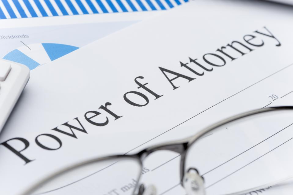 Blank power of attorney form with paperwork.