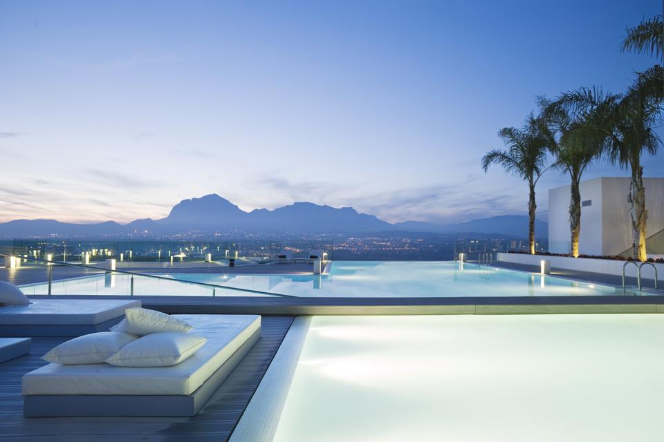Infinity pool overlooking the Spanish countryside and Mediterranean at SHA Wellness Clinic.